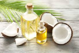 bottle of coconut oil and raw coconut